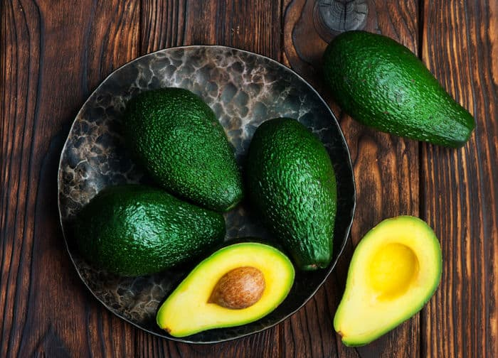 Image of green avocados on a table