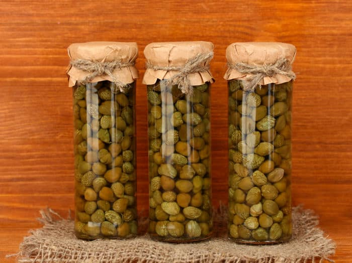 Image of capers in preserving jars