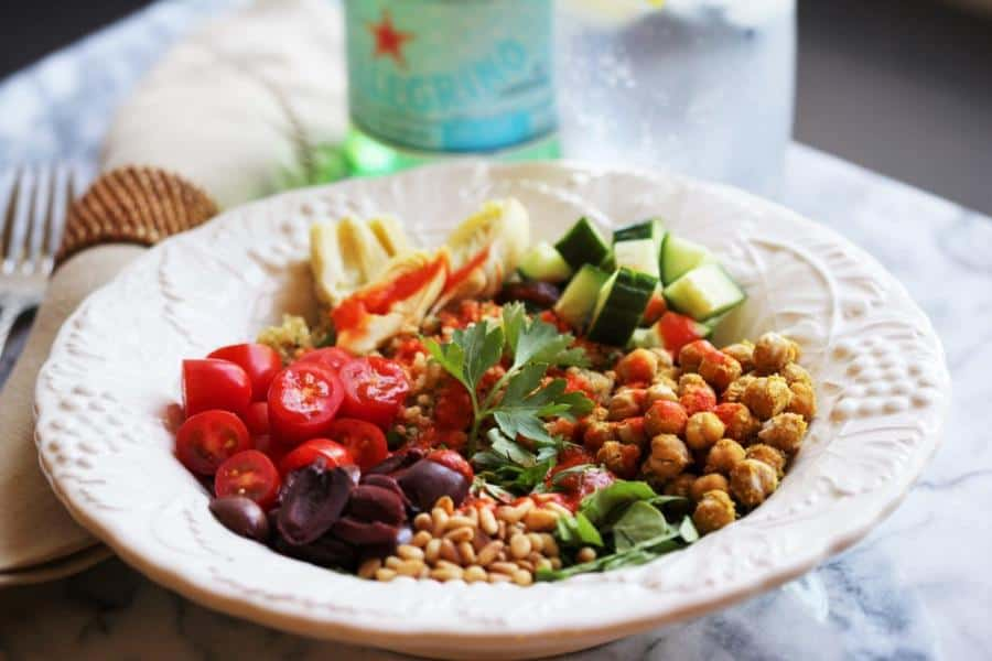 Mediterranean Quinoa Bowl with Garlic Roasted Chickpeas and Roasted Red Pepper Sauce