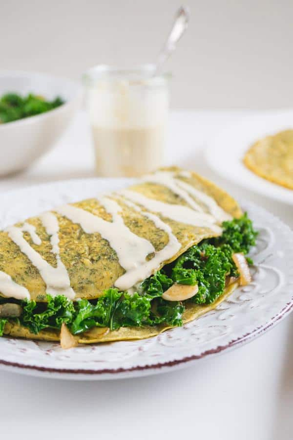 Omelet with Kale Filling and Cheesy Tahini Sauce