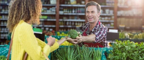 Lady purchasing fresh broccoli