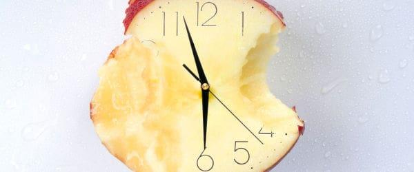 An eaten apple clock