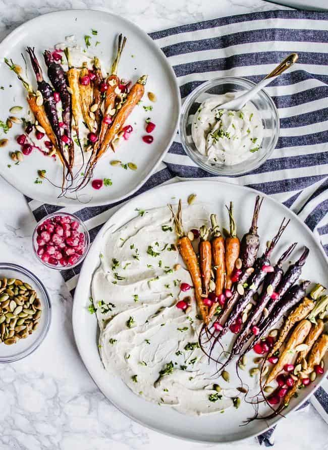 Oven Roasted Tri-Colored Carrots with Toasted Pumpkin Seeds, Pomegranate, and Garlic Tahini Yogurt